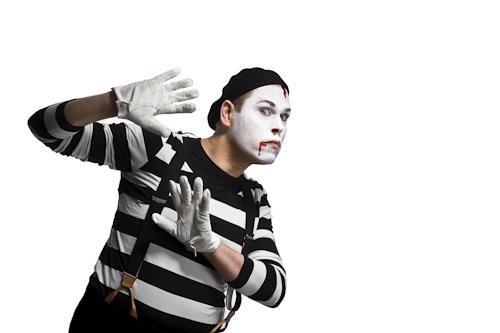 mime looking out behind invisible wall