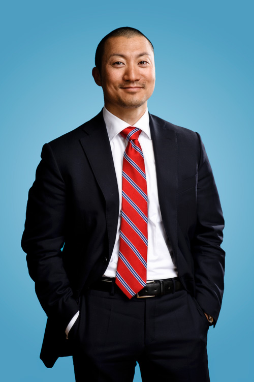 Business portrait on blue background