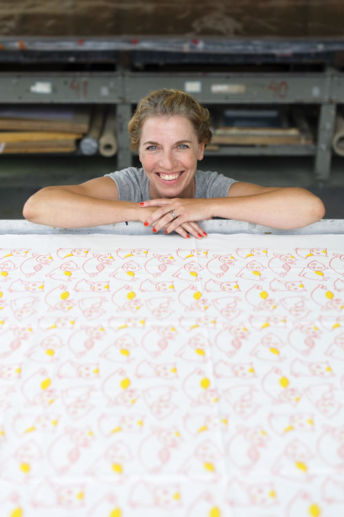 designer-in-front-of-screen-printed-fabric