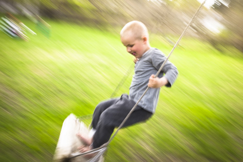 fuji-x100s-quick-review_boy-on-a-swing-panning-motion-blur